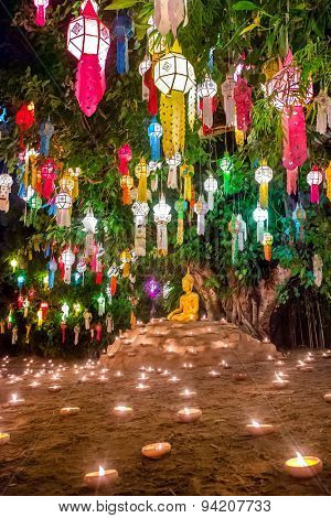 Loy Kratong Festival in Wat Pan Tao Temple, Chiangmai, Thailand. Buddha statue decorated with candles and colorful lamps
