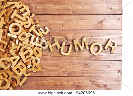 Word humor made with wooden letters