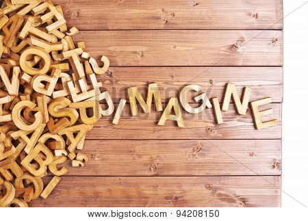Word imagine made with wooden letters