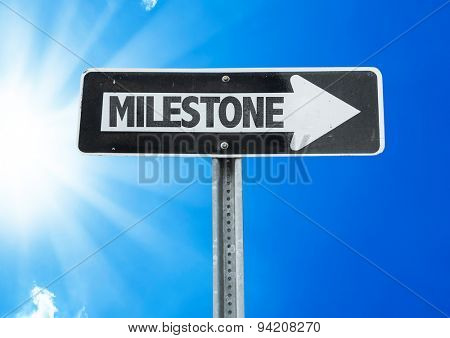 Milestone direction sign with a beautiful day