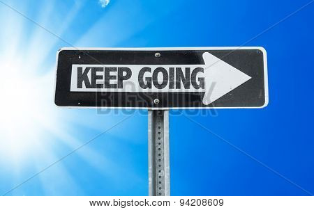 Keep Going direction sign with a beautiful day