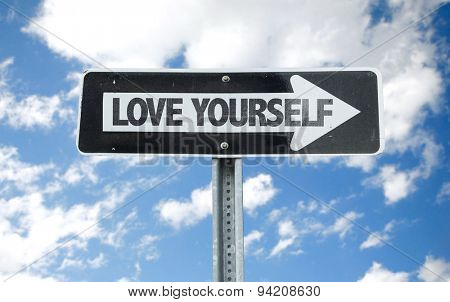 Love Yourself direction sign with sky background