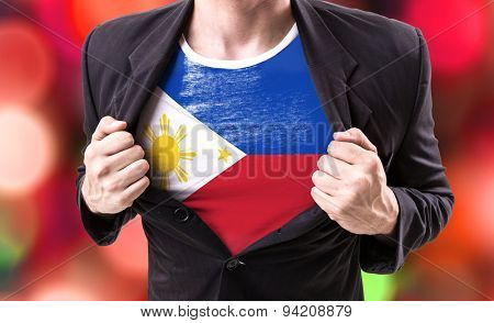 Businessman stretching suit with Philippines Flag on bokeh background