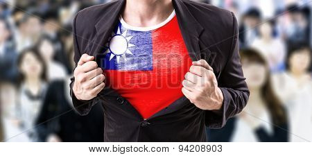 Businessman stretching suit with Taiwan Flag with a crowd people on background