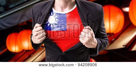 Businessman stretching suit with Taiwan Flag with red lamp on background