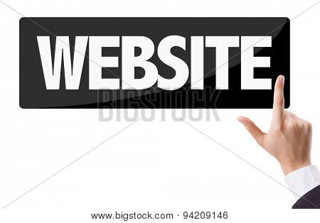 Businessman pressing button with the text: Website