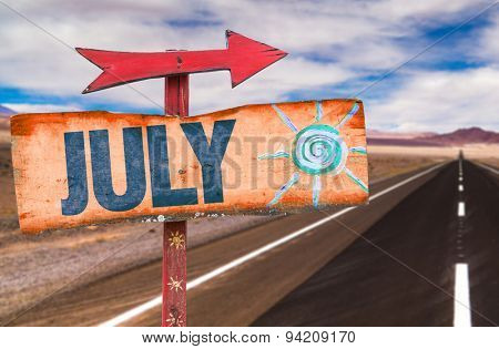 July sign with road background