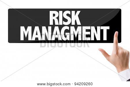 Businessman pressing button with the text: Risk Management
