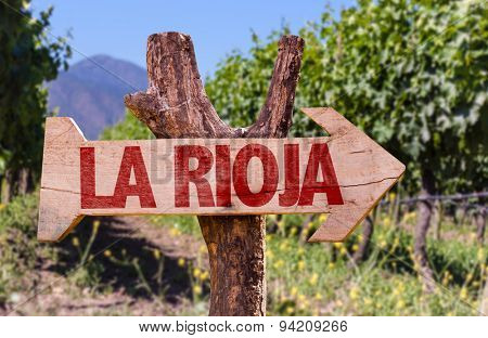 Rioja wooden sign with vineyard background