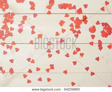 Surface covered with heart shaped confetti