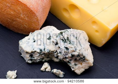 Cheeses On Black Background