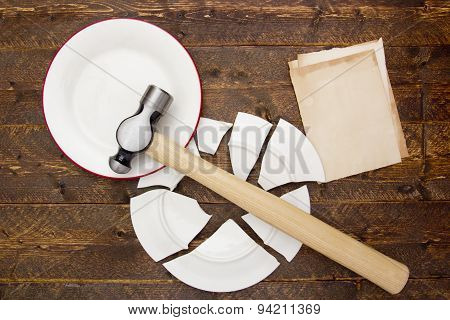 Broken Plate And Hammer