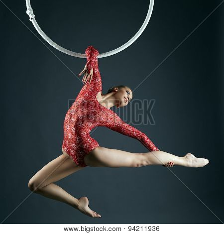 Shot of graceful female aerialist posing at camera