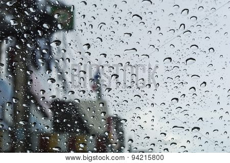 Rain Drops On Glass With A Background