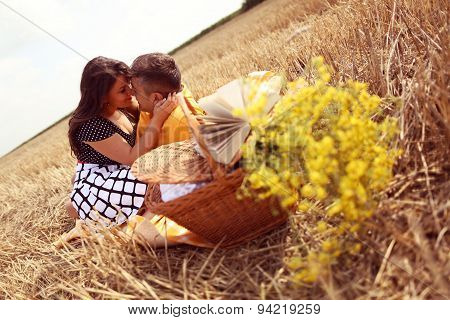 Couple Laying On Grass Having Picnick