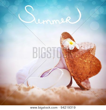 Summer vacation background, still life of of beach items with text Summer over it, white flip flops with straw hat  towel on sandy coast, summertime relaxation and holidays