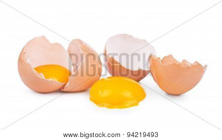 Broken Egg On Dish And Isolated On White Background