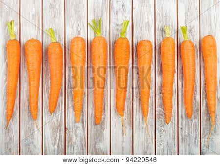 Fresh Organic Carrots Isolated On Wooden Background