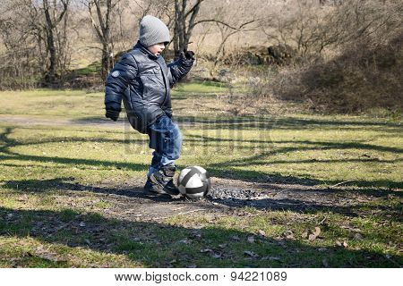 Little Boy 6-7 Years Hits The Ball To Score A Goal