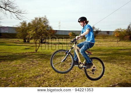 Young Boy Is Riding With The Dirtbike And Racing In The Landscape Downhill