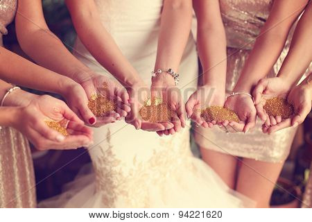 Hands Of Bride And Bridesmaid Holding Glitter