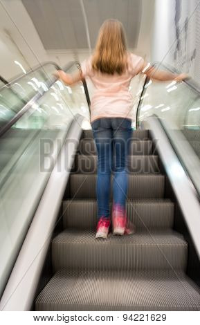 Girl In Shopping Center Standing On Moving Staircase