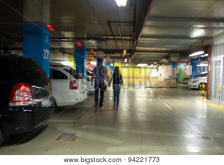 Parking Garage, Underground Interior With A Parked Cars And People