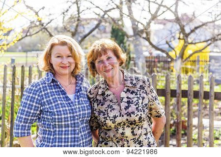 Mother And Daughter, Red Haired Looking Confident And Happy