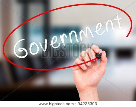 Man Hand writing Government with black marker on visual screen.