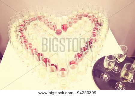 Glasses Of Champagne In Heart Shaped Setting