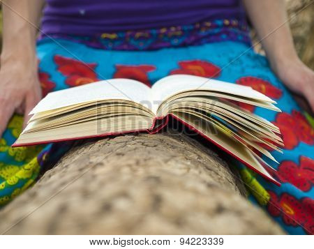 Girl Reading A Book Outdoors.