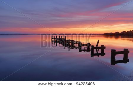 Serene Water And Stunning Sunrise At Gorokan Jetty Australia