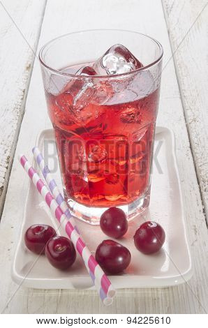 Ice Cold Cherry Juice And Freshly Washed Cherries