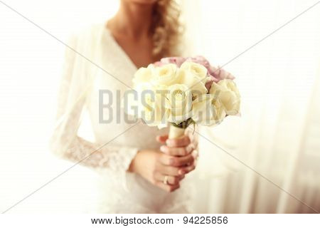 Bride Holding Wedding Bouquet Made Of Roses
