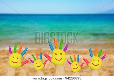Smiley On Hands Against Beach Background.