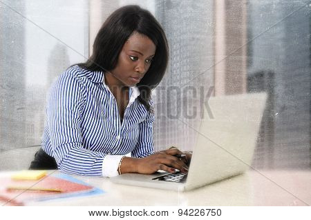 Young Attractive And Efficient Black Ethnicity Woman Sitting At Business District Office Computer La