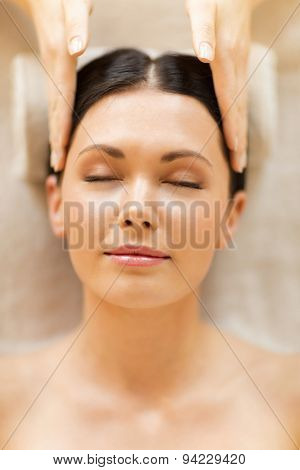 close up of woman in spa salon getting face treatment