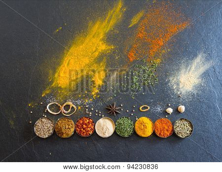Mixed Spices And Herbs On Background.