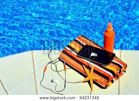 Bath Towels, Sun Spray, Cell Phone, Starfish Near The Swimming Pool