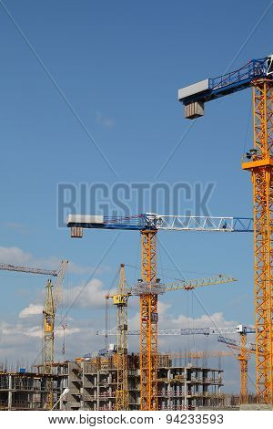 Cranes At The Construction Site Of Residential Building