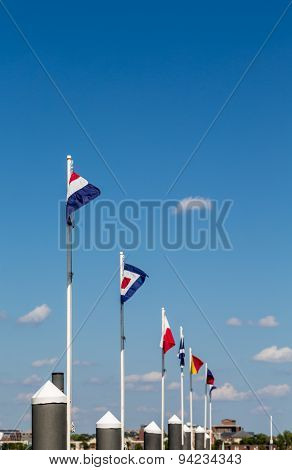 Line Of Nautical Flags Under Blue Sky