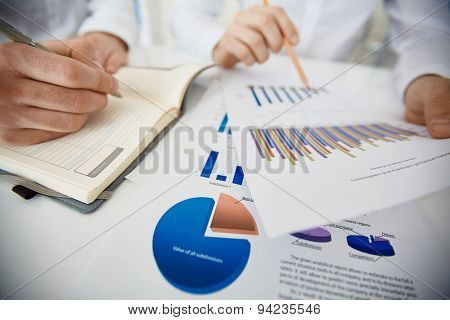 Hands of businessman during paperwork and planning