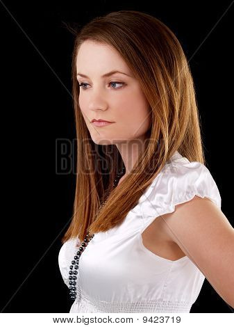 Somber Caucasian Woman White Blouse Against Dark