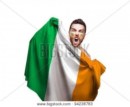 Fan holding the flag of Ireland on white background