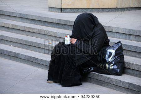 Beggar In Black Dress