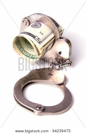 Dollars And The Handcuffs On A White Backgroun
