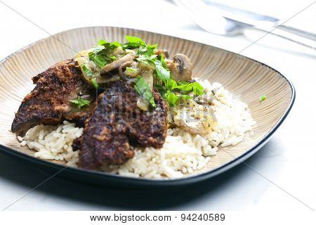fried livres with mushroom sauce and rice