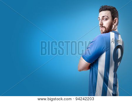 Argentine soccer player on blue background