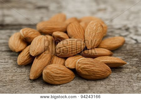 Peeled Almonds On Wooden Background. For Vegetarians