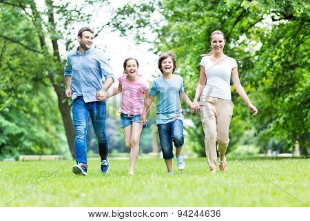 Family running in the park